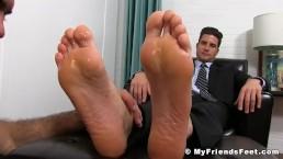 Classy jock in suit enjoying is some sloppy feet sucking