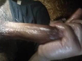 Mystery guy in black stroking his big black cock