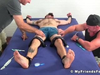 Bearded and tattooed hunk gets a sweet tickling by his buds