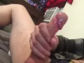 Young thin long haired guy plays with hot big cock
